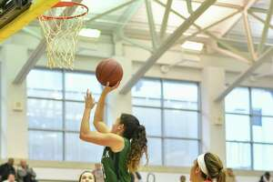 Ashley Wilson (13) of the Norwalk Bears takes a shot during a game at the 3's for Charity Holiday Tournament against the Cromwell Panthers on Friday December 28, 2018 at Newtown High School in Newtown, Connecticut.