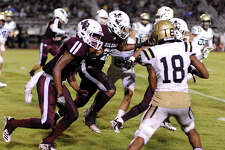 Silsbee Tiger Aaron Sells, 22, pushes for yardage against the Nederland Bulldogs. Friday, September 14, 2018 Drew Loker/special toThe Enterprise