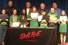 The fifth-grade DARE Graduation at Van Rensselaer Elementary School was held on Wednesday. In the photo, from left, are Rensselaer County Sheriff Deputy and DARE Officer Jeff Russo, County Executive Steve McLaughlin, Legislature Chairman Mike Stammel and Rensselaer School District Superintendent Joe Kardash. Student award recipients are Josh Kretzschmar, Ava Muller, Mia Robles, Ava Atchinson, George Krause, John Albarelli and Angelica Lawrence. (Photo provided)