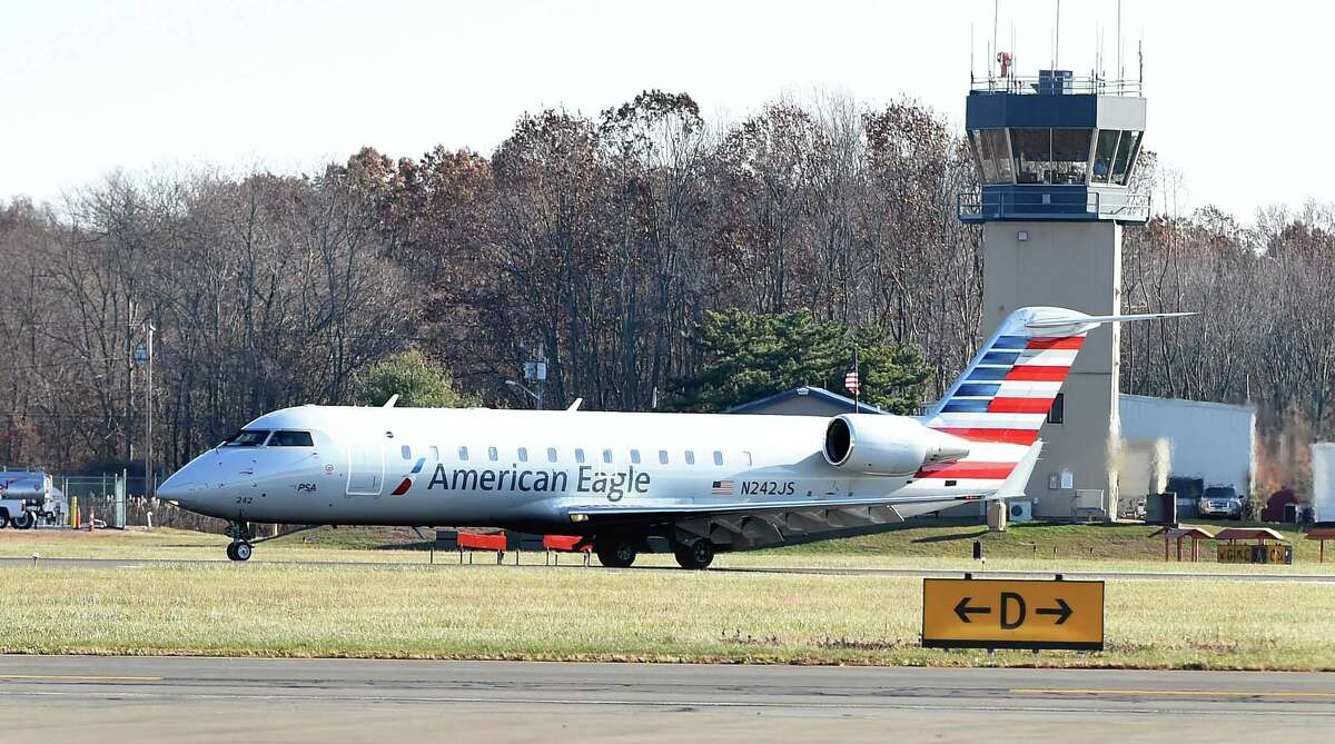 The first American Airlines Canadair RJ 200 regional jet originating in Philadelphia lands at Tweed New Haven Airport in New Haven on Nov. 29, 2017.