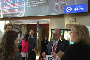 Connecticut Department of Transportation Bureau Chief for Public Transportation Richard Andreski, second from right, talks to Shore Line East commuters on Thursday, Sept. 20, 2018 in New Haven's Union Station about recent problems with the service.
