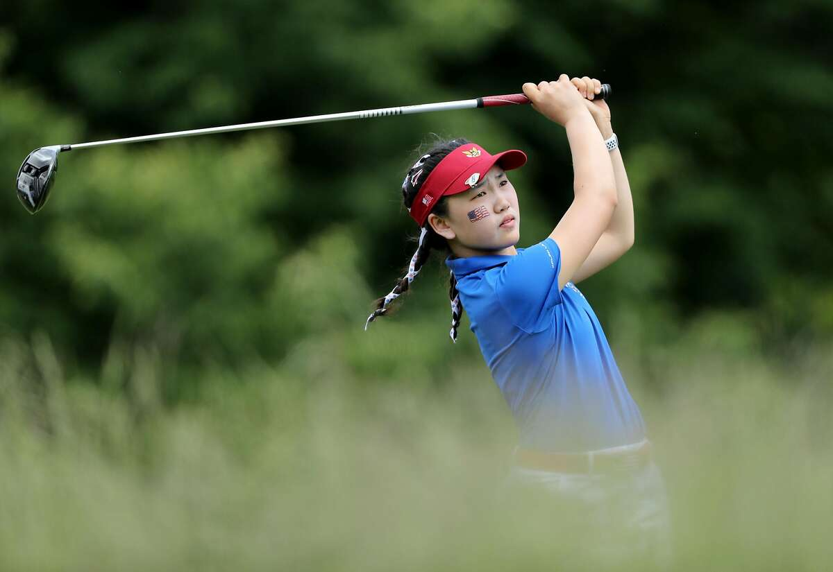 SCARSDALE, NY - JUNE 08: Lucy Li of the United States plays her tee shot on the 18th hole in her match with Jennifer Kupcho against Sophie Lamb and Olivia Mehaffey of the Great Britain and Ireland Team during the morning fourball matches in the 2018 Curt