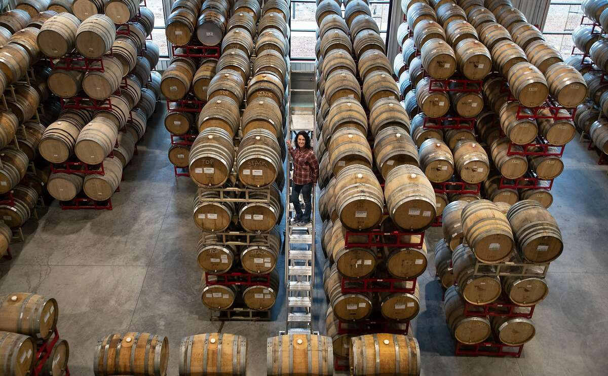 Russian River Brewing Company Co-Owner/President Natalie Cilurzo stands next to barrels of beer on Thursday, Jan. 10, 2019, in Healdsburg, CA.