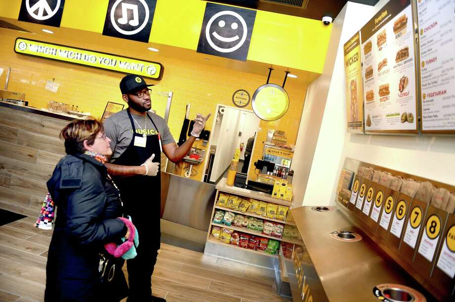 Ann Cohen DePalma (left) is assisted by shift leader Michael Stevenson with the ordering process at the new Which Wich on College St. in New Haven on January 16, 2019. Photo: Arnold Gold, Hearst Connecticut Media / New Haven Register