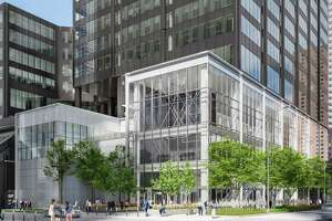 A rendering of a new two-story glass facade at 2 Houston Center.