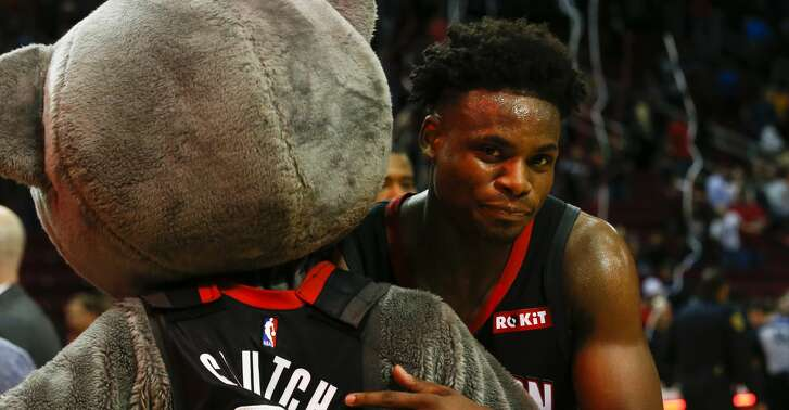 Houston Rockets forward Danuel House Jr. hugs mascot Clutch after the NBA game against the Cleveland Cavaliers at Toyota Center on Friday, Jan. 11, 2019, in Houston. The Houston Rockets defeated the Cleveland Cavaliers 141-113.