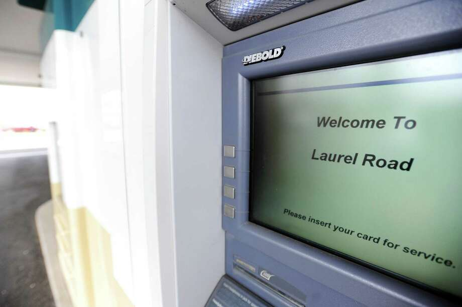 A file photo of an ATM at Laurel Road's Darien branch in April 2018. Photo: Michael Cummo / Hearst Connecticut Media / Stamford Advocate