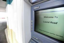 A file photo of an ATM at Laurel Road's Darien branch in April 2018.