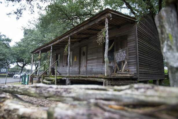 The Old Place cabin, originally built in 1823, is maintained by the Heritage Society in Sam Houston Parkin downtown Houston, Wednesday, Jan. 16, 2019.