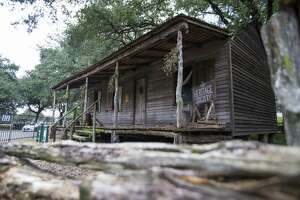 The Old Place cabin, originally built in 1823, is maintained by the Heritage Society in Sam Houston Park.