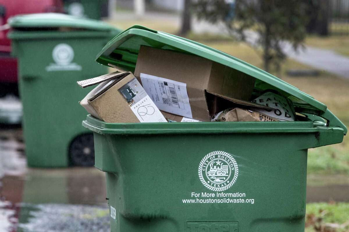 A recycling bin stands unemptied along 8th 1/2 in the Heights on Wednesday, Jan. 16, 2019, in Houston. The City of Houston has agreed to rent recycling trucks to catch up on collection.