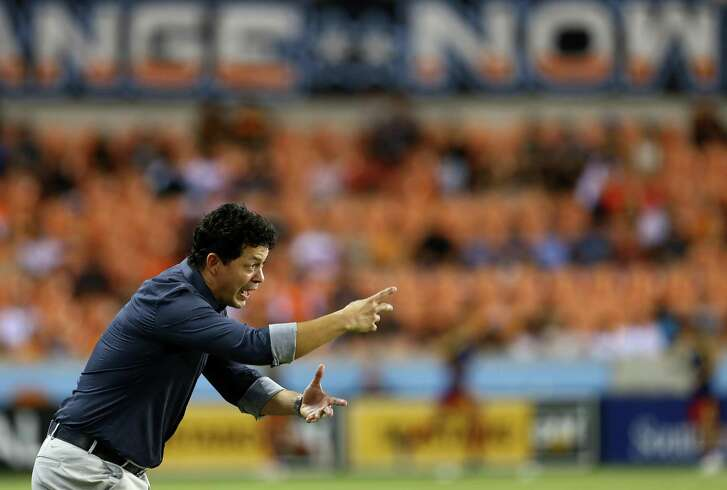 Houston Dynamo manager Wilmer Cabrera directs players from the sideline during the second half of an MLS match against the Real Salt Lake at BBVA Compass Stadium Saturday, Aug. 18, 2018, in Houston. Real Salt Lake won 2-1.