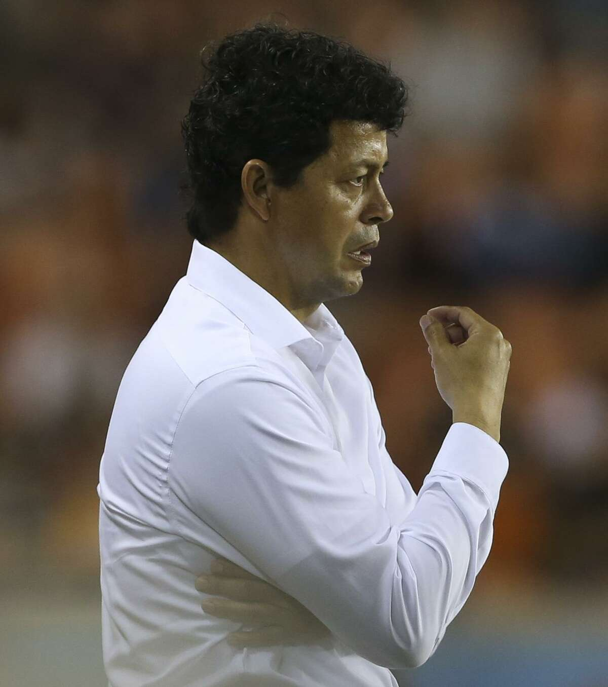 Houston Dynamo Head Coach Wilmer Cabrera watches the game against the Vancouver Whitecaps intensely during the second half of the MLS game at BBVA Compass Stadium on Saturday, March 10, 2018, in Houston. The Houston Dynamo lost to the Vancouver Whitecaps 2-1. ( Yi-Chin Lee / Houston Chronicle )