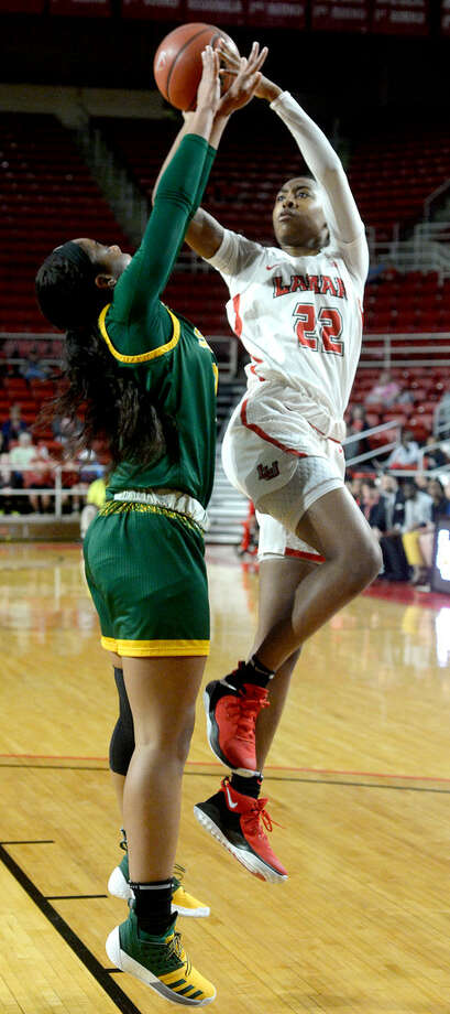 Lamar's Miya Crump shoots over the defensive efforts of Southeast Louisiana's Caitlyn Williams during their game Wednesday night at the Montagne Center.