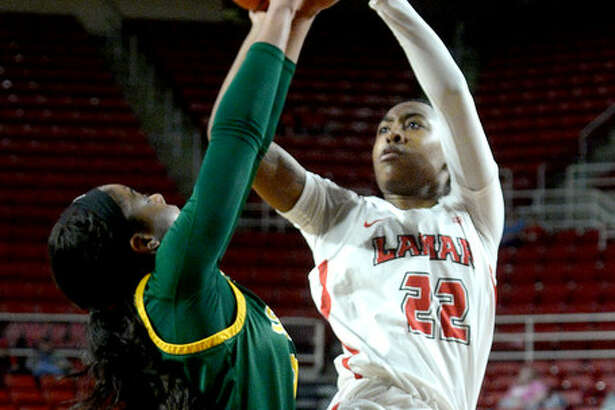 Lamar's Mya Crump shoots over the defensive efforts of Southeast Louisiana's Caitlyn Williams during their game Wednesday night at the Montagne Center. Photo taken Wednesday, January 16, 2019 Photo by Kim Brent/The Enterprise