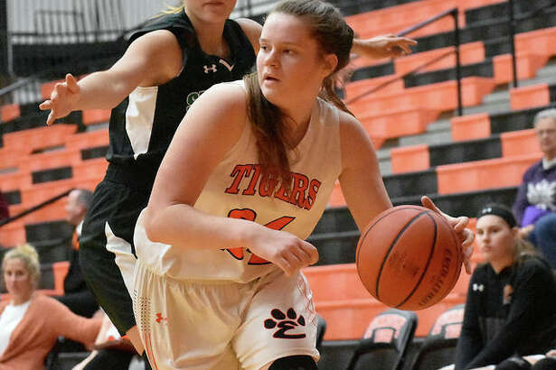 Edwardsville senior forward Madelyn Stephen dribbles the ball near the baseline late in the third quarter.