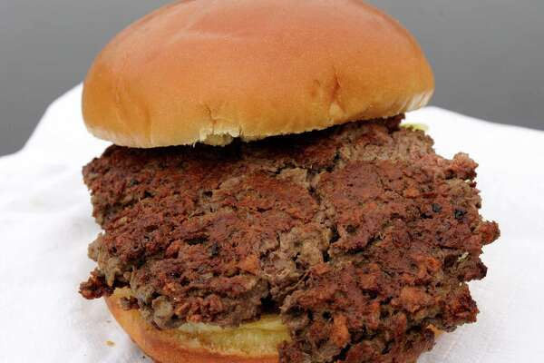 This Friday, Jan. 11, 2019 photo shows a plant-based burger made from wheat protein, coconut oil, potato protein and other ingredients in Bellevue, Neb. Released on Wednesday, Jan. 16, 2019, a report from a panel of nutrition, agriculture and environmental experts recommends a plant-based diet, based on previously published studies that have linked red meat to increased risk of health problems.