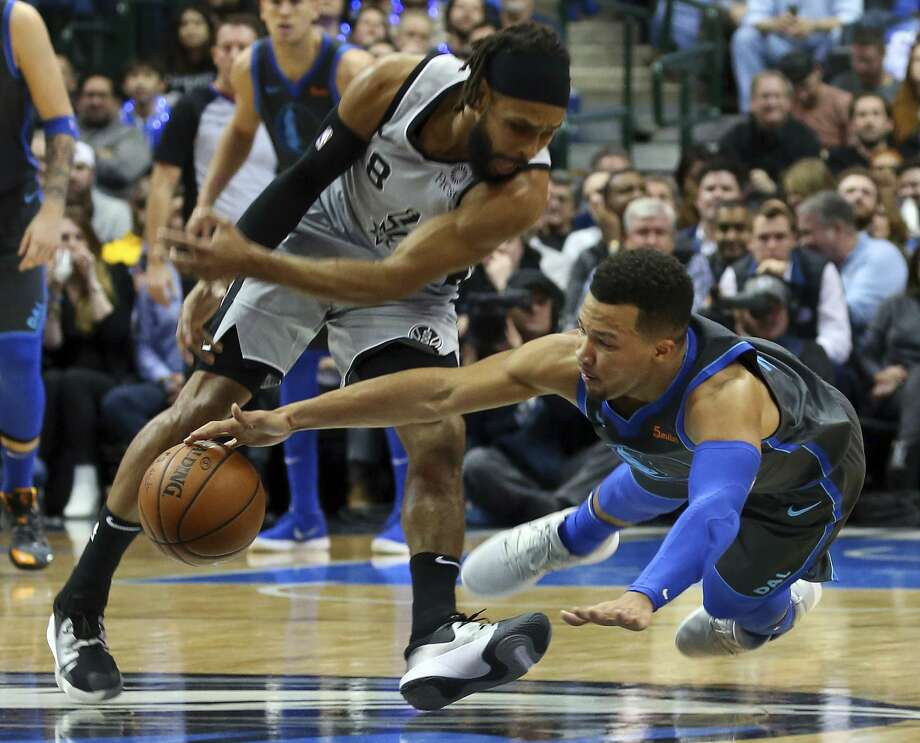 San Antonio Spurs guard Patty Mills (8) and Dallas Mavericks guard Jalen Brunson (13) chase a loose ball in the first half of an NBA basketball game, Wednesday, Jan. 16, 2019, in Dallas. (AP Photo/Richard W. Rodriguez) Photo: Richard W. Rodriguez/Associated Press