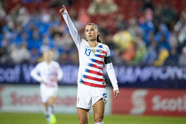 FRISCO, TX - OCTOBER 17: USA forward Alex Morgan (#13) points for a corner during the CONCACAF Women's Championship gold medal game between the USA and Canada on October 17, 2018 at Toyota Stadium in Frisco, TX.  (Photo by Matthew Visinsky/Icon Sportswire via Getty Images).