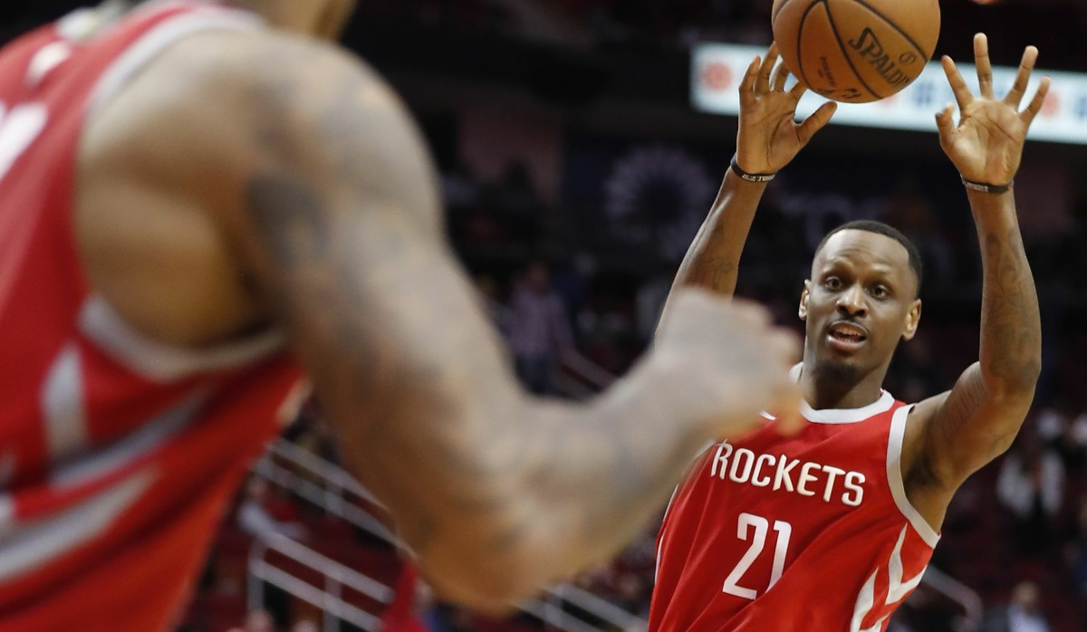 Houston Rockets forward James Nunnally (21) makes a pass to Houston Rockets forward PJ Tucker (17) during overtime an NBA basketball game against the Brooklyn Nets at Toyota Center on Wednesday, Jan. 16, 2019, in Houston.