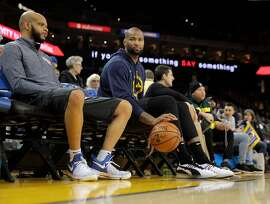 DeMarcus Cousins sits on the bench after warming up before the Golden State Warriors played the New Orleans Pelicans at Oracle Arena in Oakland, Calif., on Wednesday, January 16, 2019.