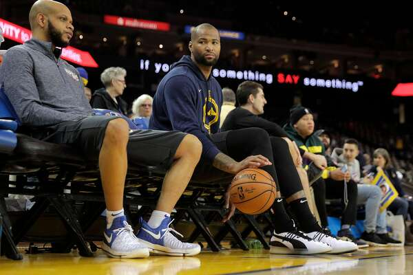 0f39e857a34 1of8DeMarcus Cousins sits on the bench after warming up before the Golden  State Warriors played the New Orleans Pelicans at Oracle Arena in Oakland,  Calif., ...