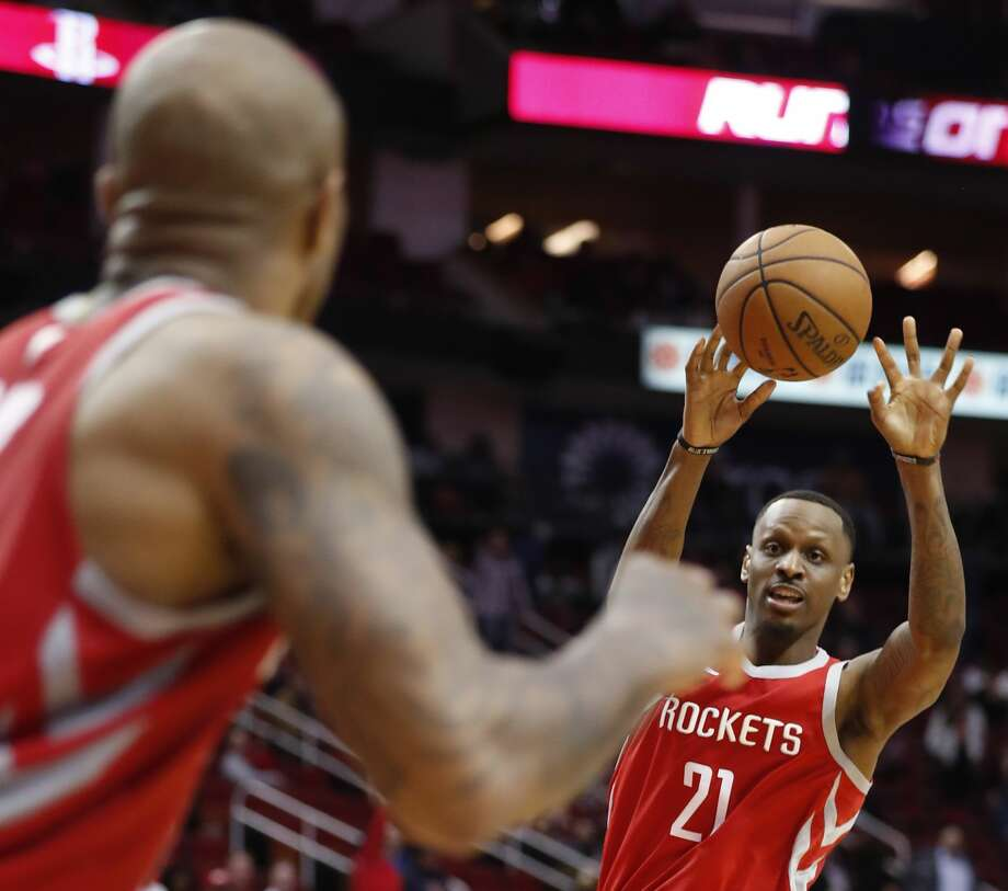 Houston Rockets forward James Nunnally (21) makes a pass to Houston Rockets forward PJ Tucker (17) during overtime an NBA basketball game against the Brooklyn Nets at Toyota Center on Wednesday, Jan. 16, 2019, in Houston. Photo: Brett Coomer/Staff Photographer