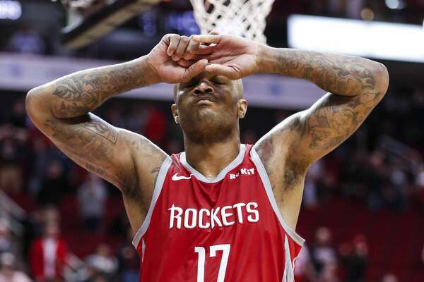 Houston Rockets forward PJ Tucker (17) walks off the floor after the Rockets lost 145-142 in overtime to the Brooklyn Nets in an NBA basketball game at Toyota Center on Wednesday, Jan. 16, 2019, in Houston.