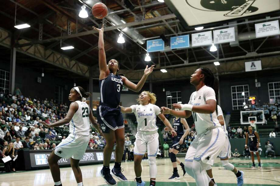UConn's Megan Walker (3) goes to the basket over Tulane's Kaila Anderson (1), Krystal Freeman (23) and Tatyana Lofton (11) on Wednesday in New Orleans. Photo: Gerald Herbert / Associated Press / Copyright 2019 The Associated Press. All rights reserved.