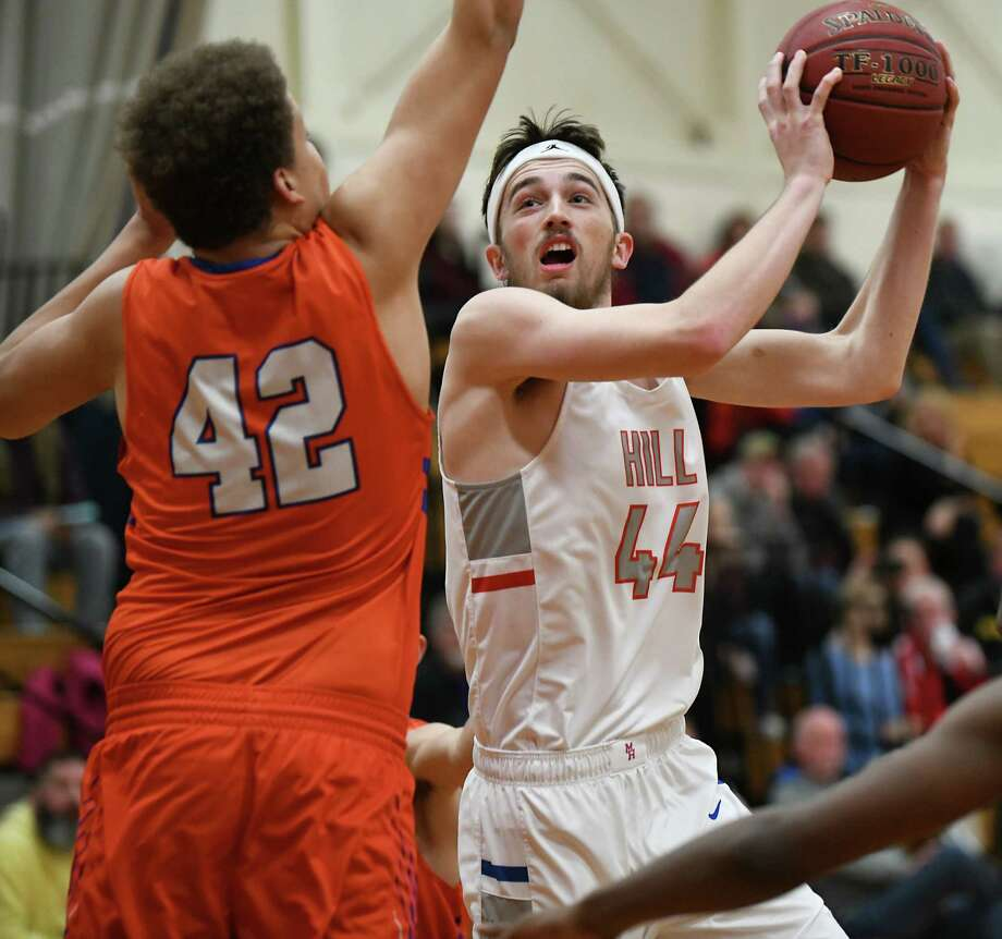 Maple Hill's Nate Mannion, #44, drives to the hoop guarded by Catskill's Logan Scott during a basketball game on Wednesday, Jan. 16, 2019 in Schodack, N.Y. (Lori Van Buren/Times Union) Photo: Lori Van Buren / 40045918A