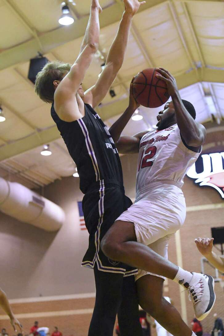 Augustine Ene, right, of UIW, drives as Hayden Koval of Central Arkansas defends during college basketball action in the McDermott Convocation Center on Wednesday, Jan 16, 2019.