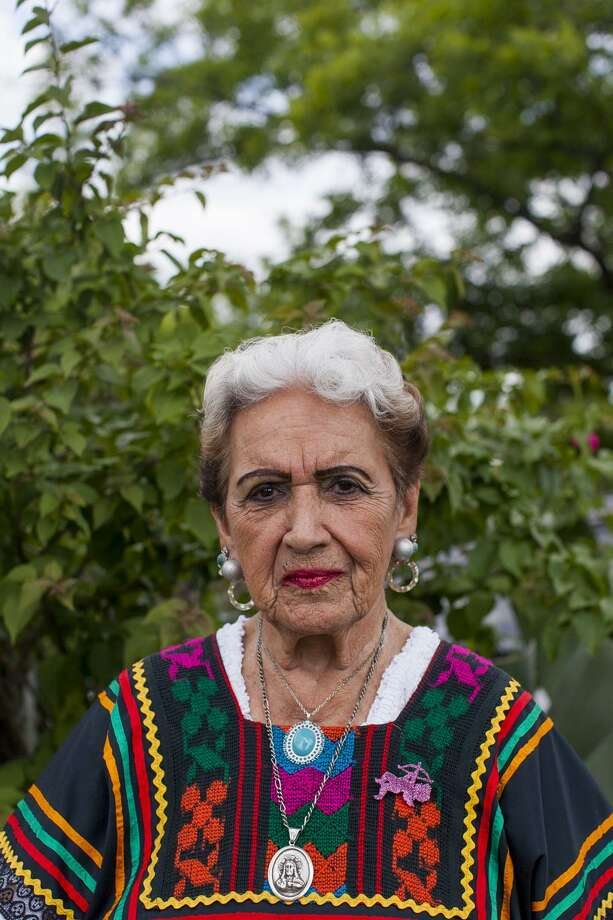 "Portrait of Golden age ranchera singer Rita Vidaurri, 90, outside of her home Monday May 4, 2015. Vidaurri's mother died when Rita was 14 years old, ""My mother was an angel."" / Julysa Sosa For the San Antonio Express-News"
