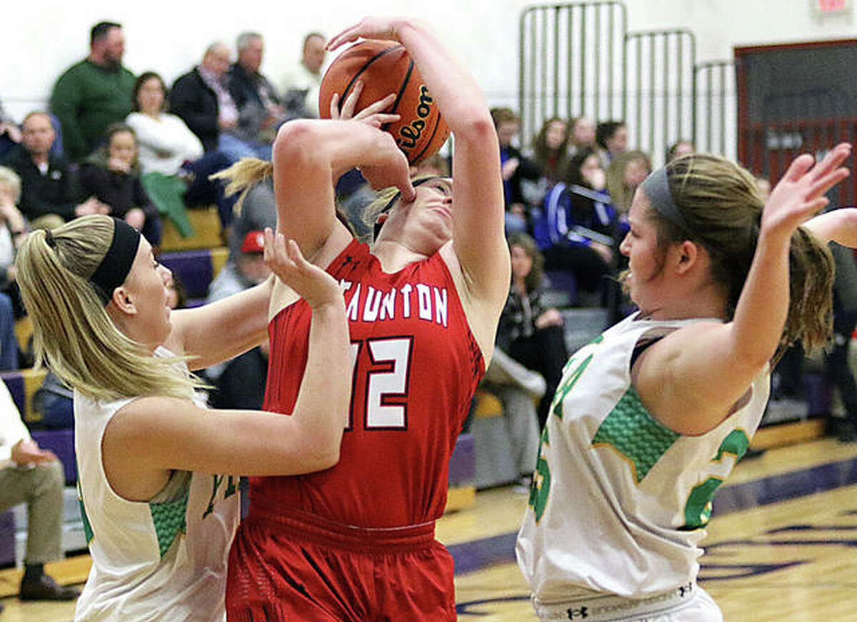 Staunton's Rebecca Caldieraro (middle) draws a foul while putting up a shot between Southwestern's Addie Green (left) and Molly Novack on Wednesday night in Mount Olive.
