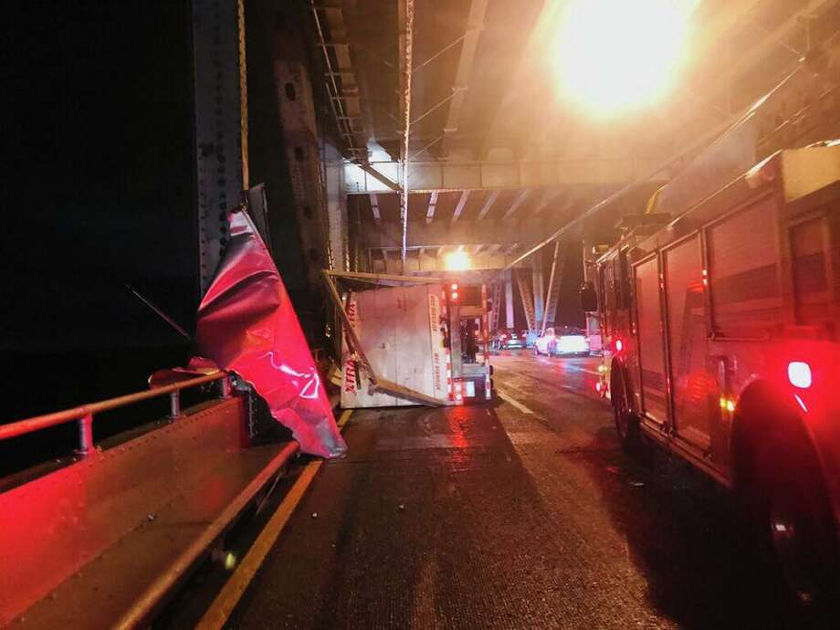 High winds from an unrelenting storm toppled a big rig on the Richmond-San Rafael Bridge. Photo: CHP Marin