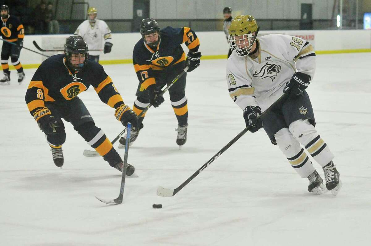 Tom Kuryla (19) of the Notre Dame Fairfield Lancers shoots and scores a first period goal during a game against the Simsbury Trojans on Wednesday January 16, 2019 at The Rinks in Shelton, Connecticut.