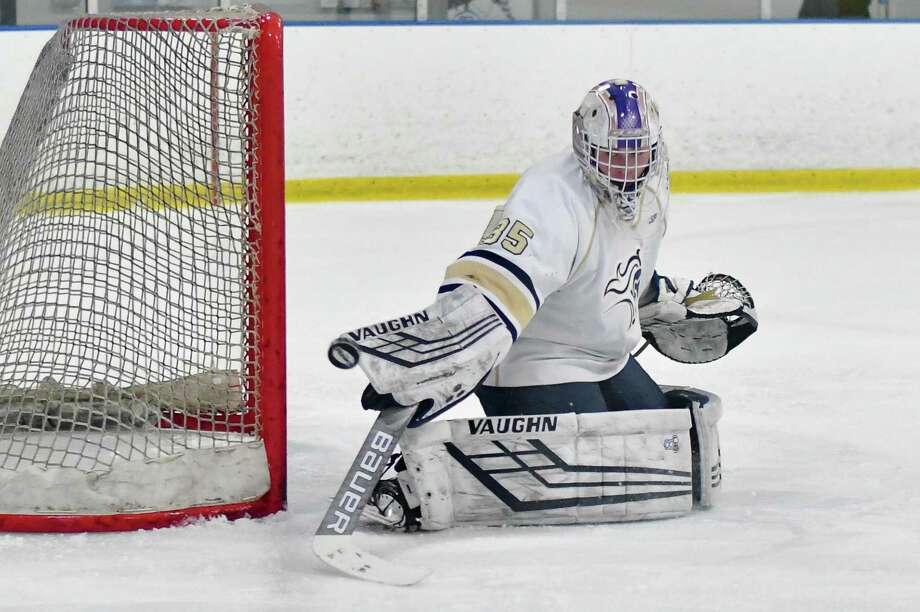 Goalie Kacy Adams (35) of the Notre Dame Fairfield Lancers makes a save during a game against the Simsbury Trojans on Wednesday January 16, 2019 at The Rinks in Shelton, Connecticut. Photo: Gregory Vasil / For Hearst Connecticut Media / Connecticut Post Freelance