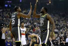 OAKLAND, CALIFORNIA - JANUARY 16: Kevin Durant #35 and Draymond Green #23 of the Golden State Warriors high five during their game against the New Orleans Pelicans at ORACLE Arena on January 16, 2019 in Oakland, California. NOTE TO USER: User expressly acknowledges and agrees that, by downloading and or using this photograph, User is consenting to the terms and conditions of the Getty Images License Agreement. (Photo by Ezra Shaw/Getty Images)