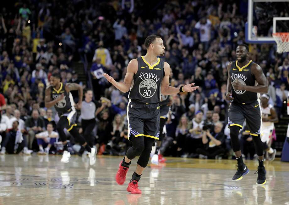 Stephen Curry (30) celebrates a three pointer in the second half as the Golden State Warriors played the New Orleans Pelicans at Oracle Arena in Oakland, Calif., on Wednesday, January 16, 2019. Photo: Carlos Avila Gonzalez / The Chronicle