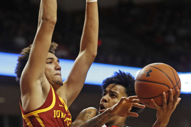 Texas Tech freshman guard Kyler Edwards tries to get around Iowa State freshman forward George Conditt IV for a bucket during Big 12 Conference men's basketball play on Wednesday night at United Supermarkets Arena in Lubbock.