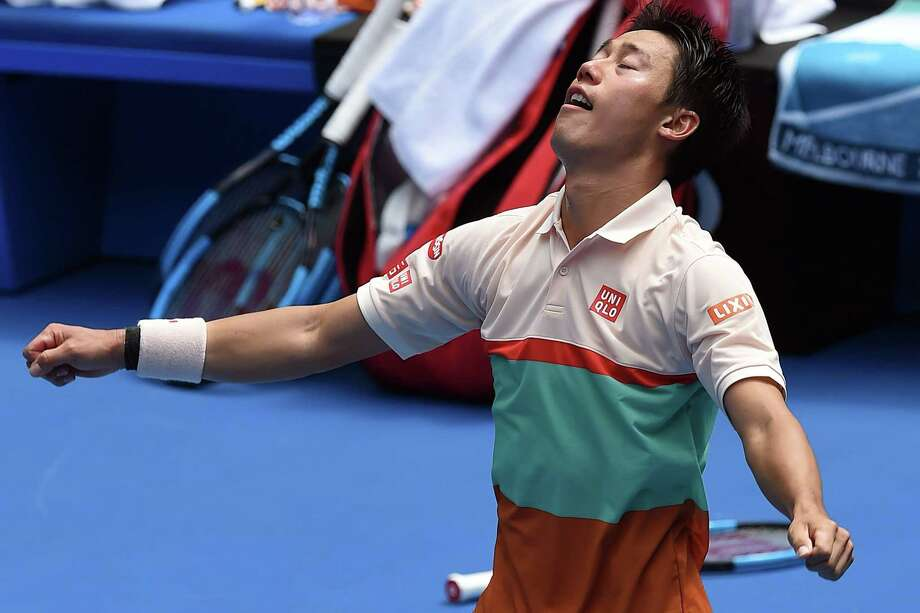 Kei Nishikori celebrates his five-set victory against Ivo Karlovic in Melbourne. Nishikori won the first two against Karlovic, but dropped the 11th games of the third and fourth sets, and had to save three break points in a crucial 10th game of the fifth set before winning. Photo: GREG WOOD / AFP/Getty Images / AFP or licensors