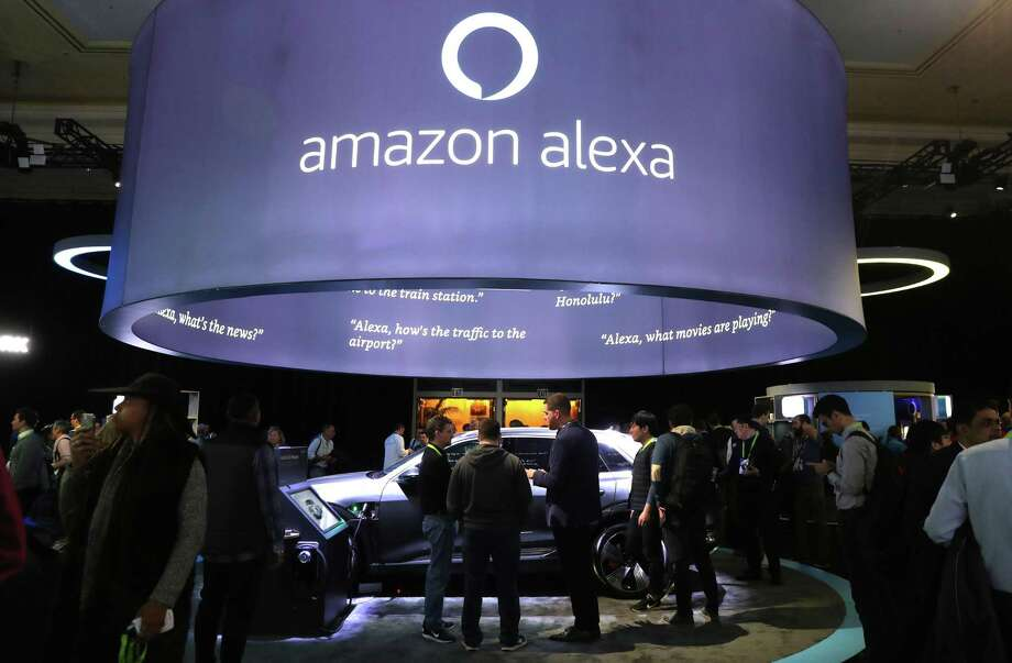 Attendees visit the Amazon booth during the CES 2019 show in January 2019, in Las Vegas. (Photo by Justin Sullivan/Getty Images) Photo: Justin Sullivan / Getty Images / 2019 Getty Images