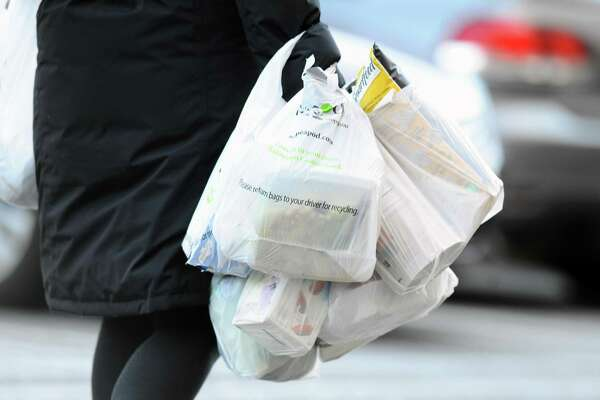 Customers exit Stop & Shop with plastic bags inside the Ridgeway Shopping Center between Summer St. and Bedford St. in Stamford, Conn. on Monday, March 26, 2018. Stamford lawmakers are attempting to ban single-use plastic bags.