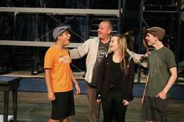 "La Porte High School students, from left, Adrian Escareno, Zoe Gibson and Luke Boriskie, rehearse a scene from Disney's ""Newsies the Musical"" with the help of Jay Watson, one of the associate directors of the production."