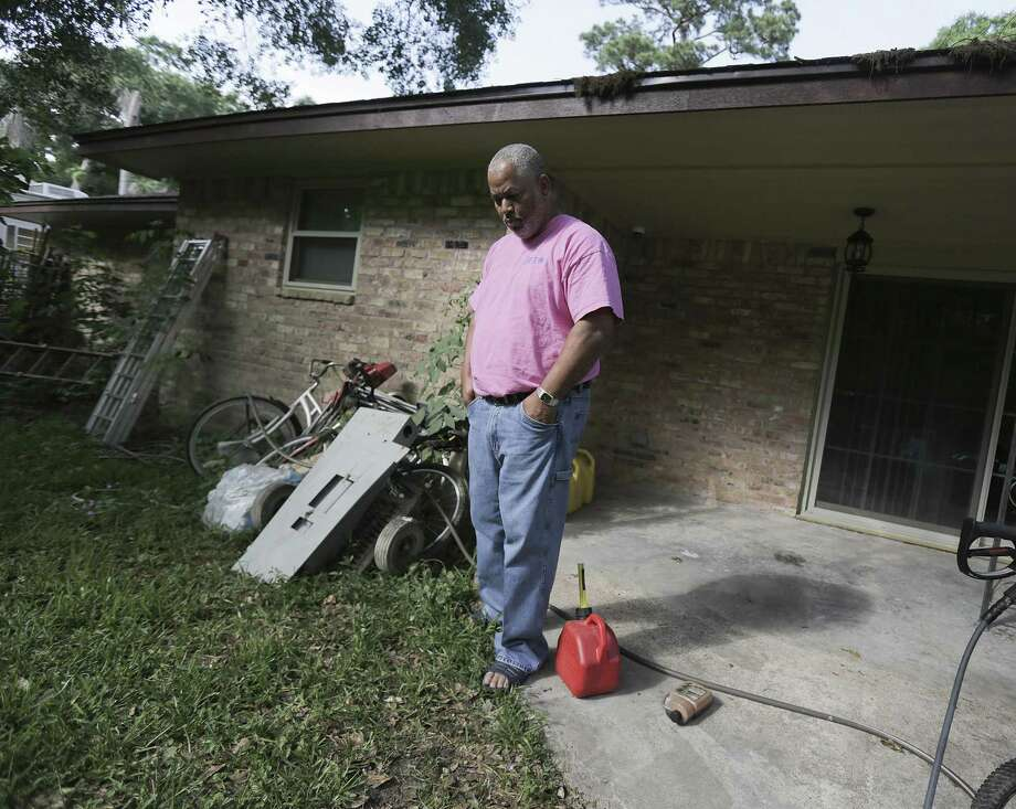 Kenneth Mitchell stands in the backyard of his and his wife's home that was damaged in Harvey on Monday, May 14, 2018 in Houston. The couple, who just moved back into their home a few weeks ago, got assistance from Northwest Assistance Ministries after their home flooded and help in getting back into their home. Although the interior had been renovated the couple have started working on the backyard, removing debris that had floated in from the storm. (Elizabeth Conley/Houston Chronicle) Photo: Elizabeth Conley, Staff Photographer / Houston Chronicle / ©2018 Houston Chronicle