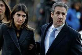 Michael Cohen, former personal lawyer to U.S. President Donald Trump, arrives at federal court with his daughter Samantha Cohen, left, in New York on Wednesday, Dec. 12, 2018.