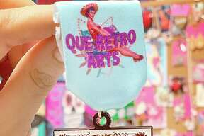 Que Retro Arts (Mira Medals): $10Where to buy: Inside Little Shops of Wonderland (Wonderland of the America's mall
