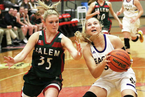 CM's Jenna Christeson (right) goes up for a shot after beating Salem's Katelyn Biegeleisen to the ball during a first-round game at the Highland Tourney on Monday. The Eagles came back Wednesday night and beat Nashville in a quarterfinal.