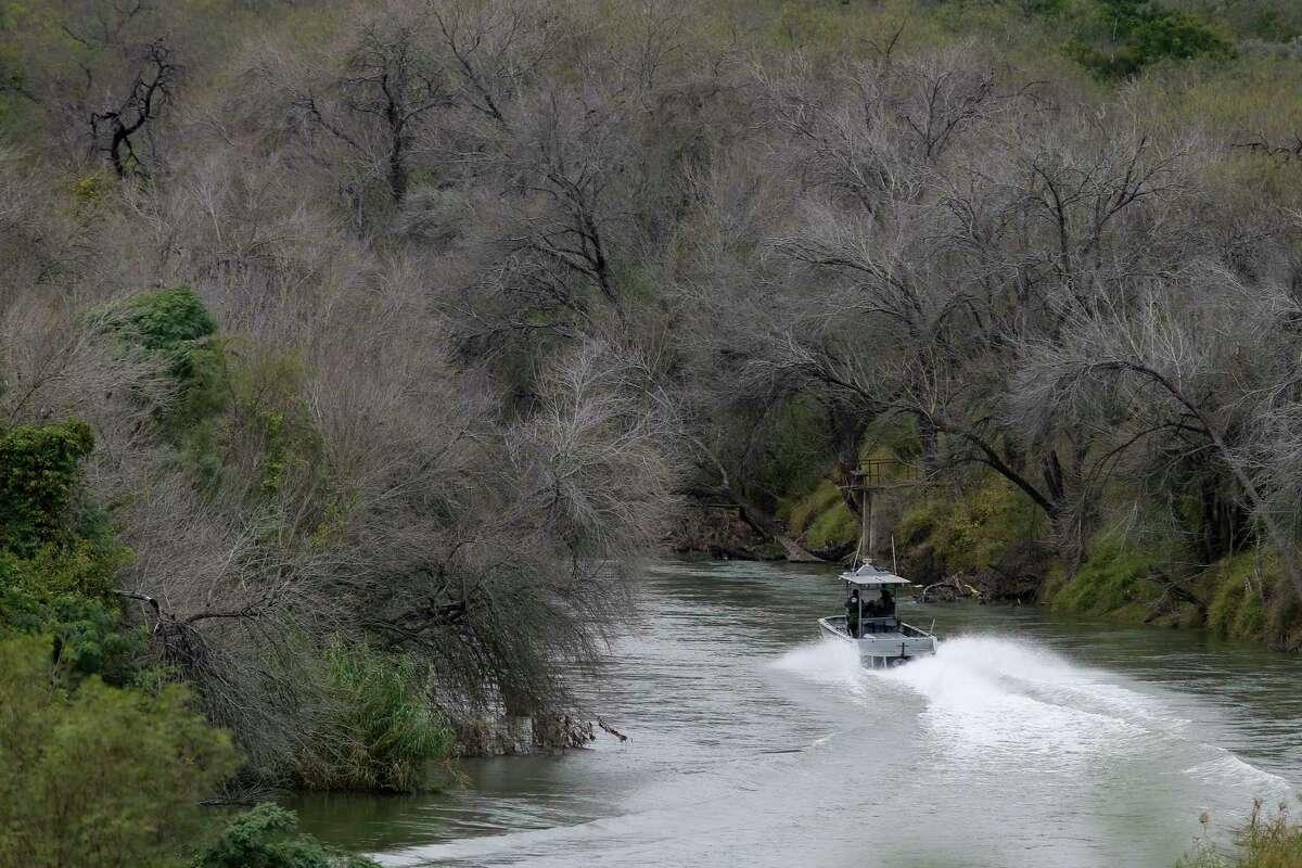 A U.S. Border Patrol boat patrols the Rio Grande between Roma, Texas and Ciudad Miguel Aleman, Texas, Wednesday, Jan. 9, 2019.
