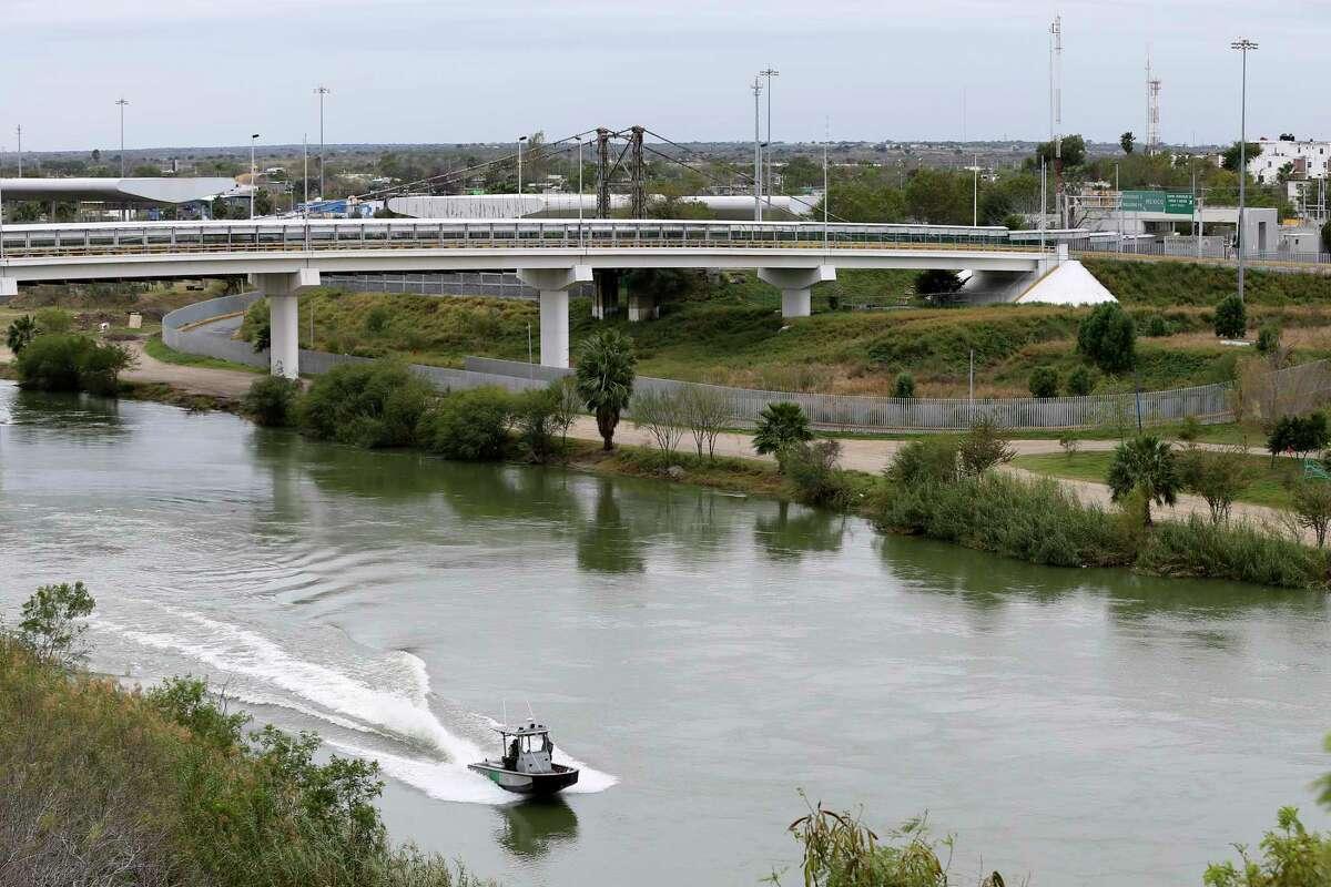 A U.S. Border Patrol boat patrols the Rio Grande between Roma, Texas and Ciudad Miguel Aleman, Texas, on the right, Wednesday, Jan. 9, 2019.