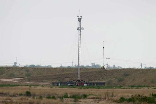"""The heavily fortified border includes surveillance towers up and down the RIo Grande. This one near Granjeno is just north of """"El Rinco del Diablo,"""" which was the main crossing point used by Central American families and unaccompanied minors seeking asylum during a surge in 2014."""